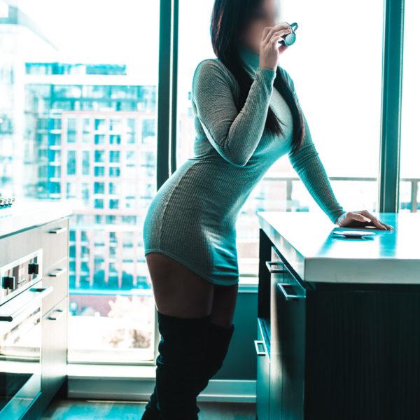 Breanne Banks Toronto Ontario escort in kitchen with bright window behind her